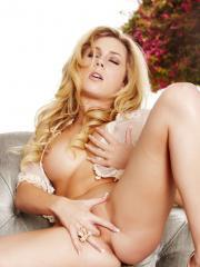 Gorgeous blonde Julia Crown shows off her perfect curves in nothing but lacy lingerie