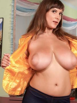 Busty hair dresser Valory Fleur exposing her huge tits to a client