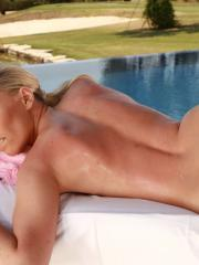 Eve Angel and Taylor Shay give each other sensual massages by the pool