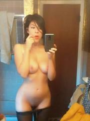 Brunette coed takes selfies of her hot busty body in the bathroom