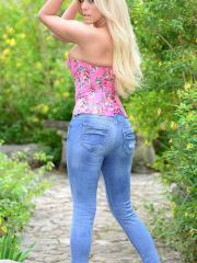 xoGisele rocks tight denim jeans and a corset top and she plays with her flesh colored dildo