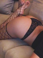 Gisele plays with her pink dildo in sexy black panties and fishnet stockings