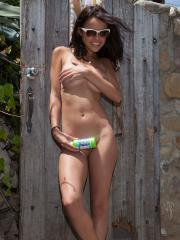 Brunette coed Dillion Harper has some fun outside on a warm summer day