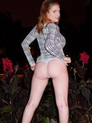 Beautiful redhead Lilith Lust shows you what's up her pretty skirt